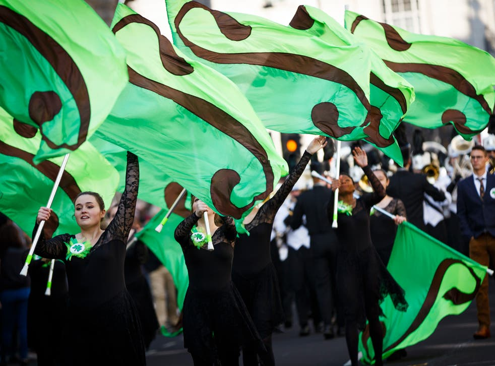 Members of the Coppell High School Marching Band take part in the St Patrick's Day parade through central London