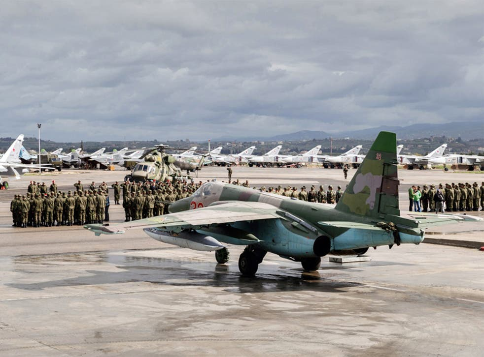 Russian troops at Hemeimeem air base in Syria on Tuesday