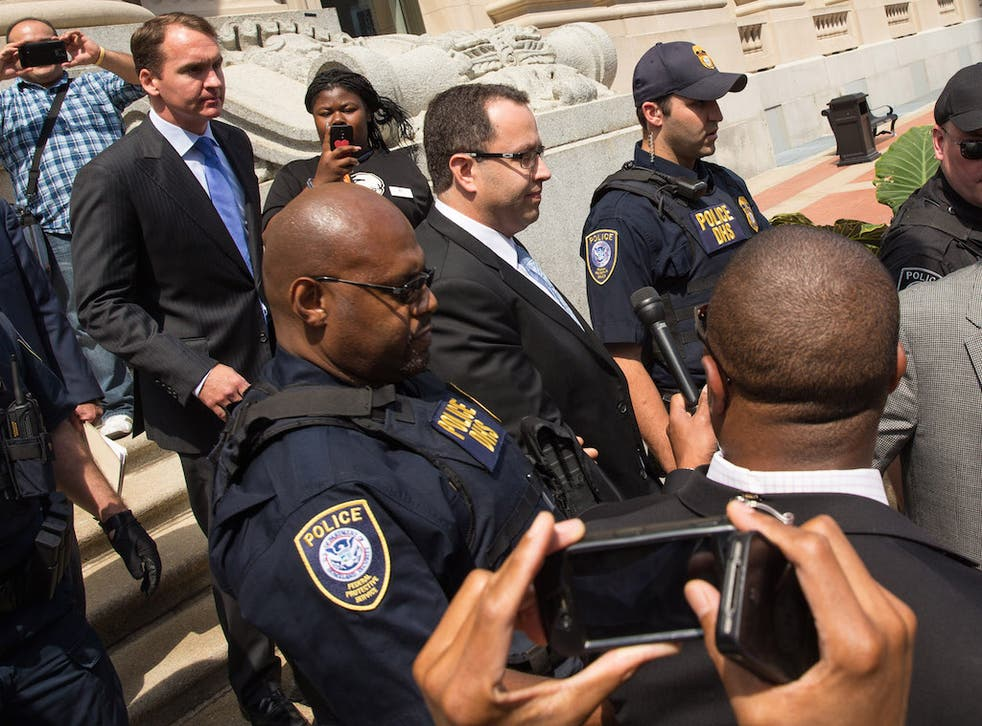 Jared Fogle (center), the former Subway spokesman, has reportedly been beaten up in prison.