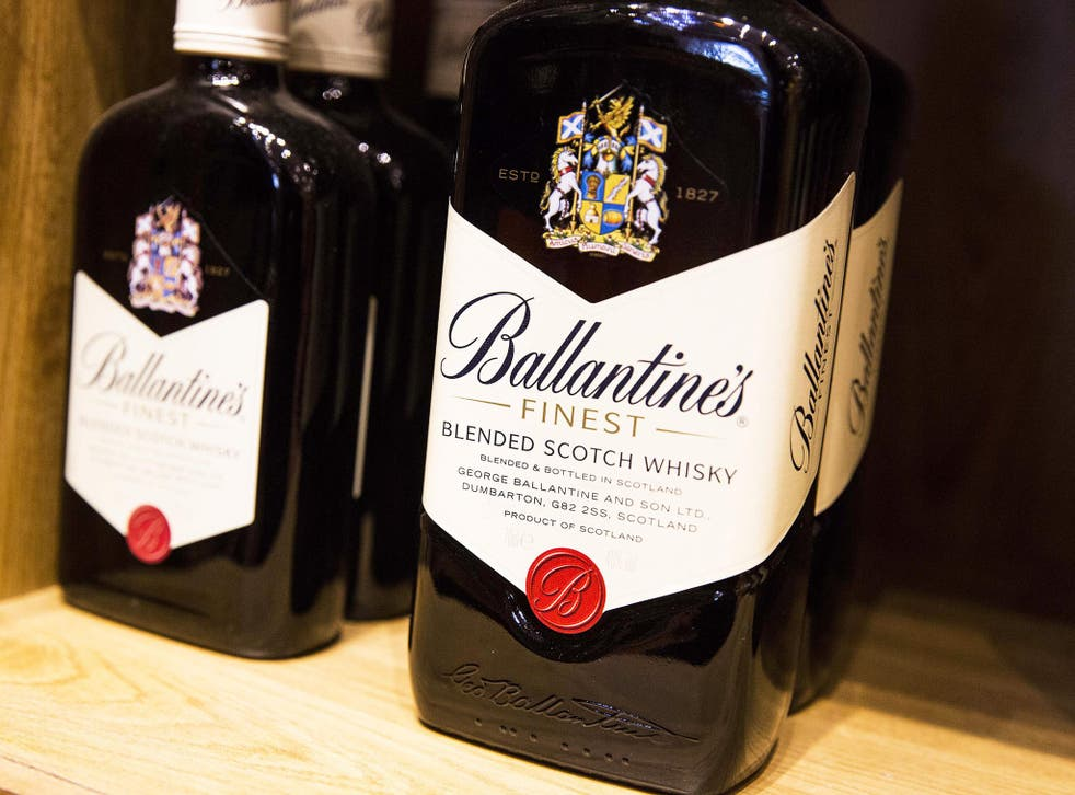 Bottles of Ballantines scotch whiskey, produced by Pernod Ricard SA, sits on a shelf in a restaurant in Paris, France