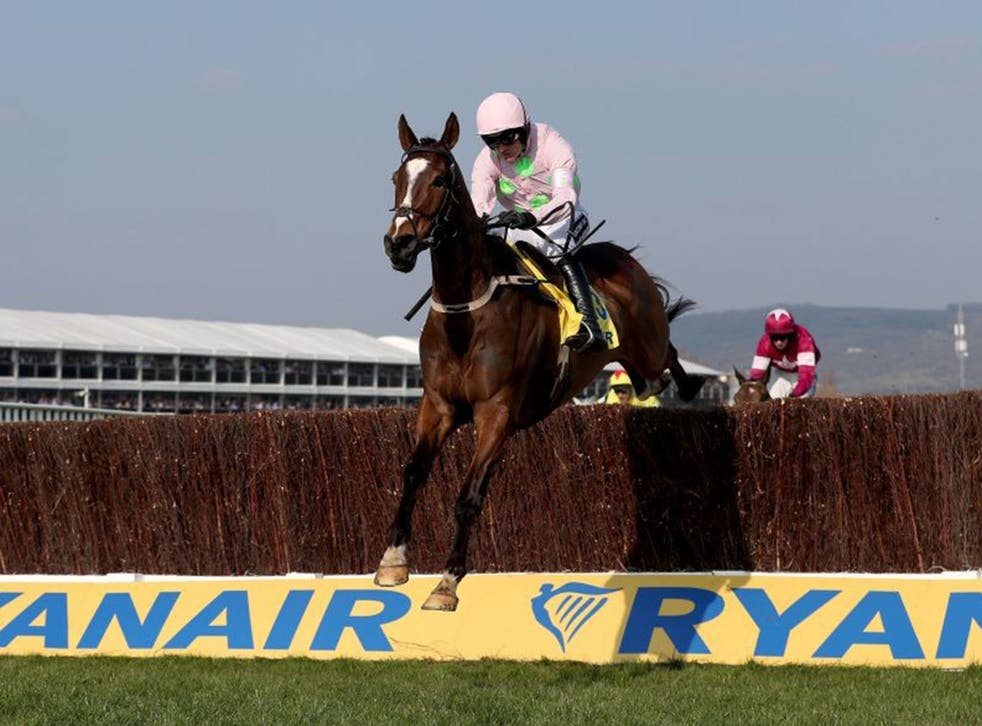 Ruby Walsh on Vautour leaps over the final fence on his way to victory in the Ryanair Chase