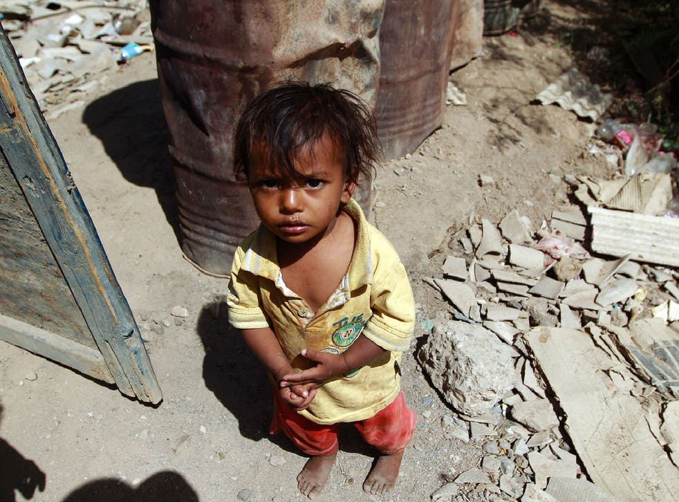 A Yemeni child stands outside the family house which was destroyed several months ago in an air-strike by the Saudi-led coalition at a slum in the capital Sanaa