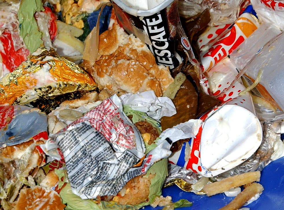 A bin overflows with food waste in central London