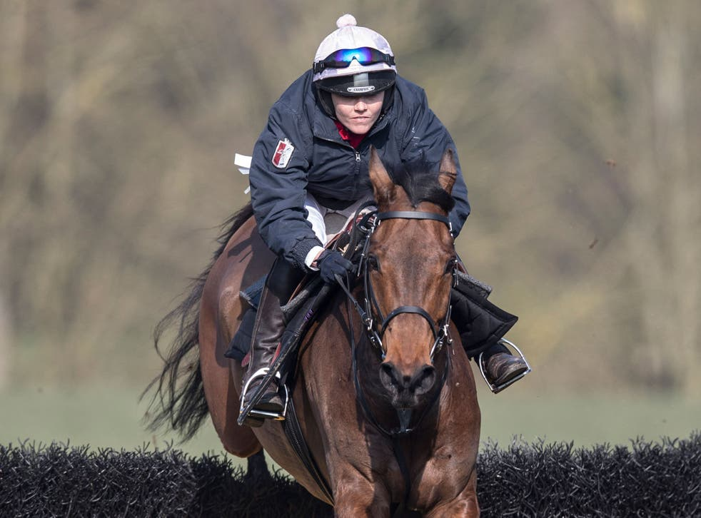 Victoria Pendleton on Minella Theatre clears a jump on the gallops at Aston Rowant in Oxfordshire