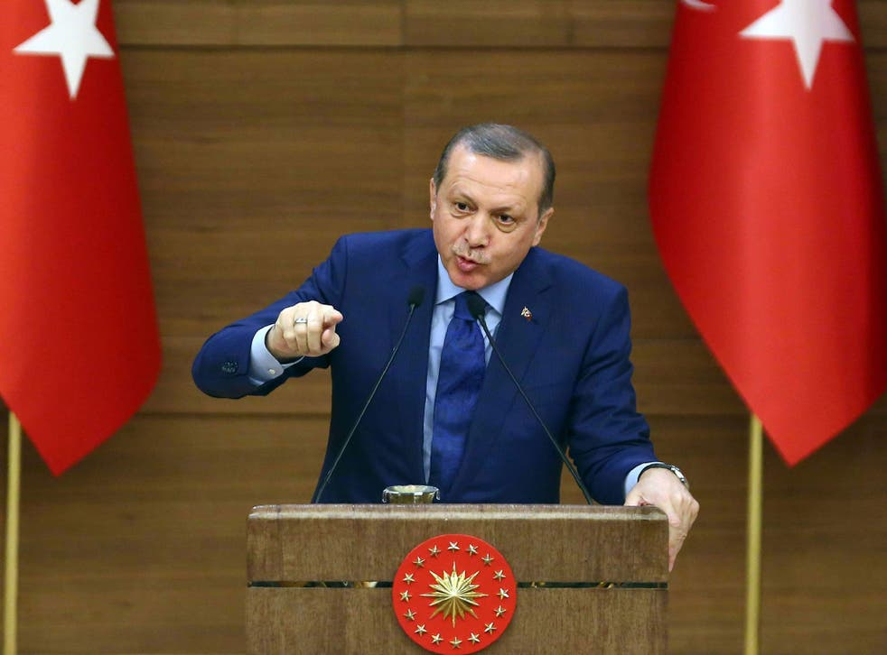 Turkish President Recep Tayyip Erdogan gestures as he delivers a speech during the mukhtars (local town government heads) meeting at the Presidential Complex in Ankara on March 16, 2016
