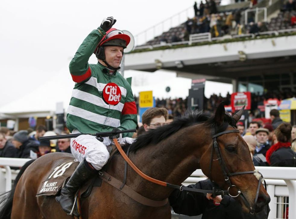 Noel Fehily celebrates on Unowhatimeanharry after riding to victory in the Novices' Hurdle