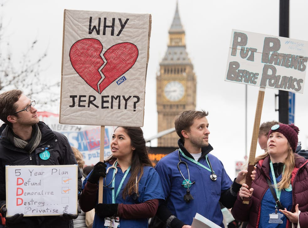 Junior doctors protest with banners outside St Thomas' Hospital in central London