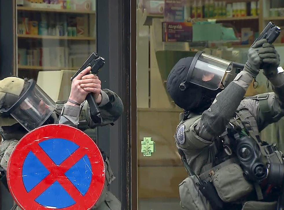 Belgian police target the flat in Molenbeeck, Brussels, where Salah Abdeslam was arrested yesterday