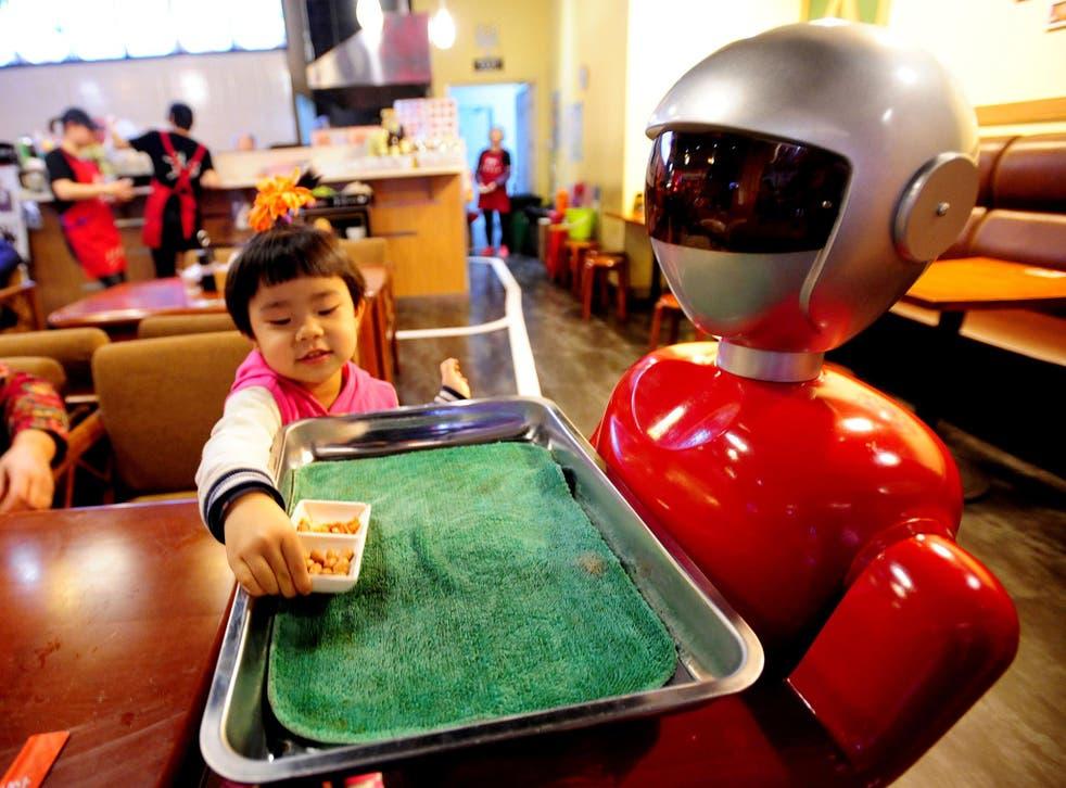 A robot serves food at a restaurant in Shenyang, China