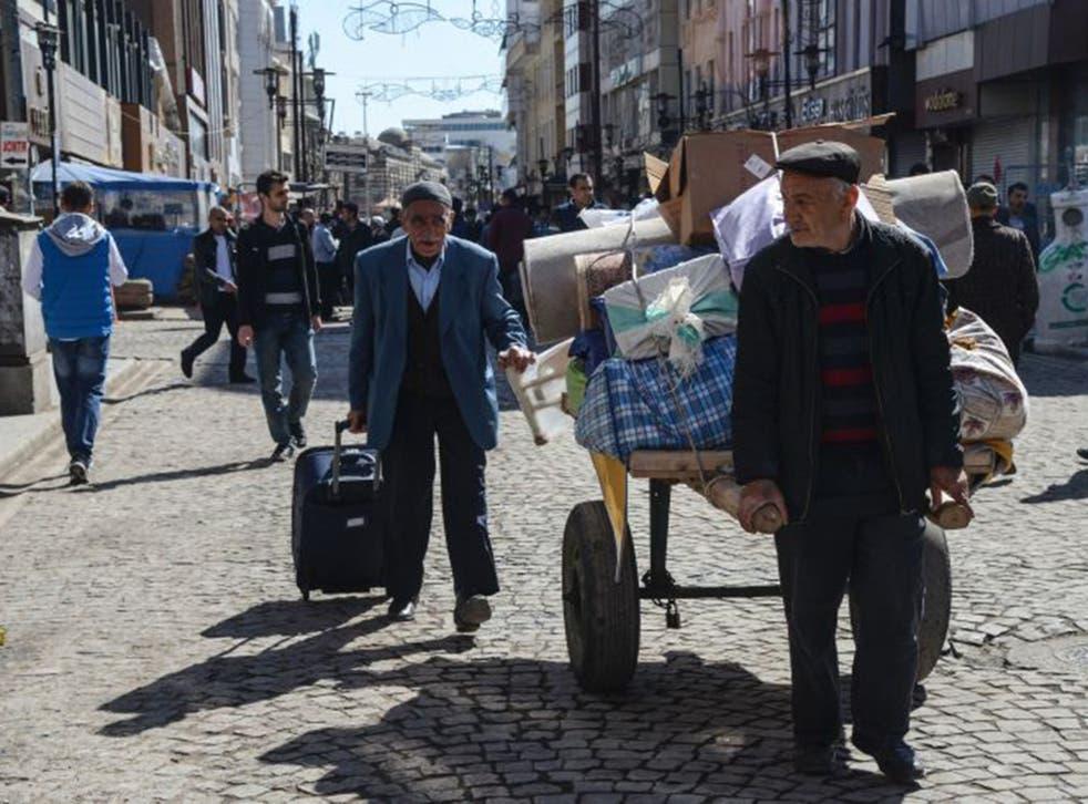 Home again: Turkish Kurds returning to Diyarbakir last week