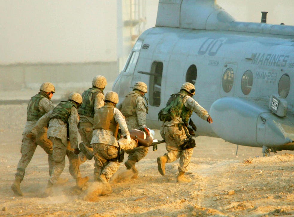 US Marines carry an injured colleague in Iraq