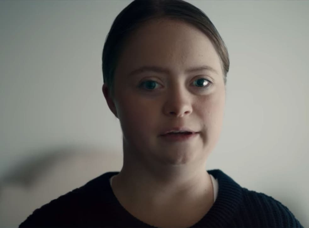 A young woman with Down Sydrome appears in the charity's video