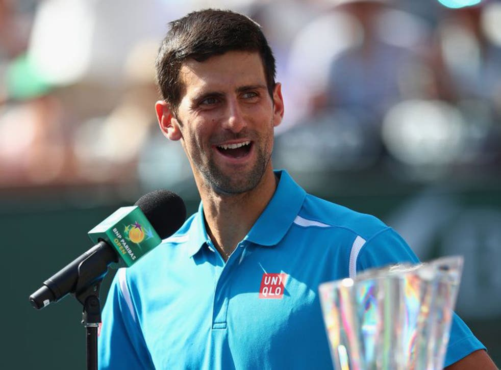 Novak Djokovic talks to the crowd after his win over Milos Raonic at Indian Wells