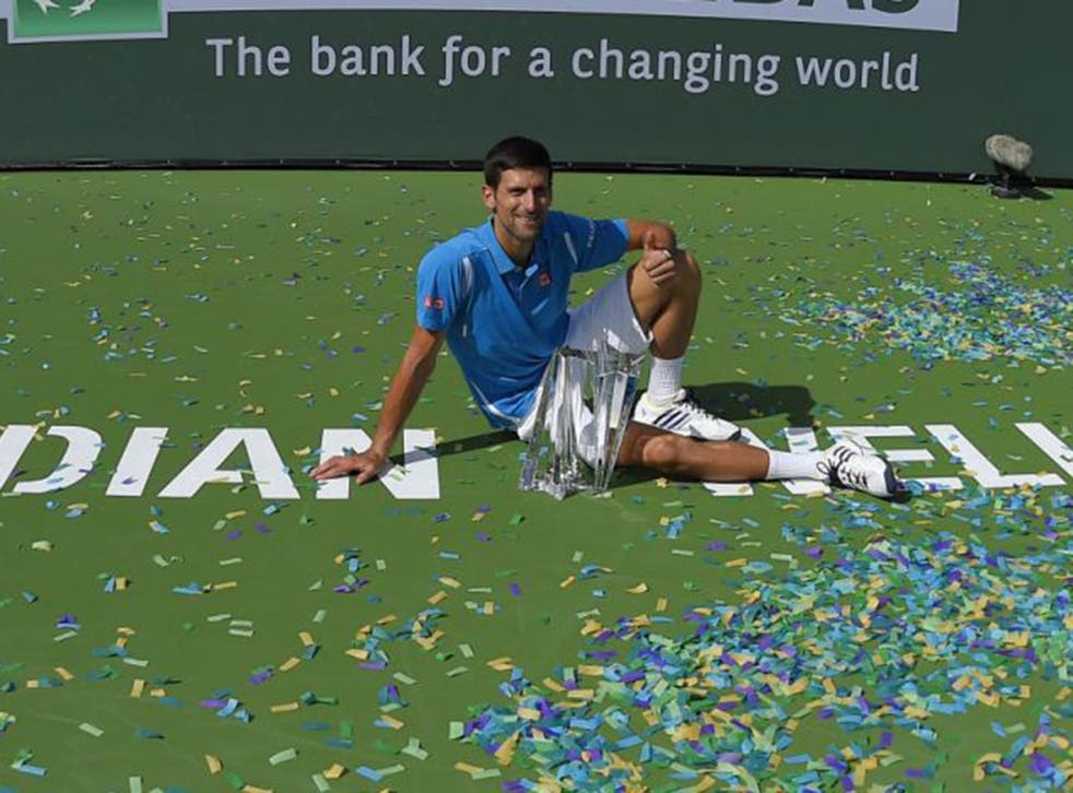 World No 1 Novak Djokovic celebrates winning the Indian Wells tournament on Sunday but is under fire for his outspoken views on equal pay