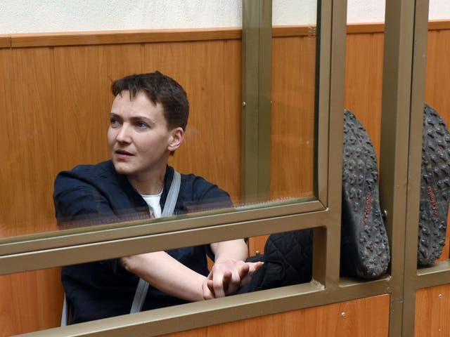 Ukrainian military pilot Nadiya Savchenko sits inside a defendant's cage during her sentencing hearing at a court in the southern Russian town of Donetsk