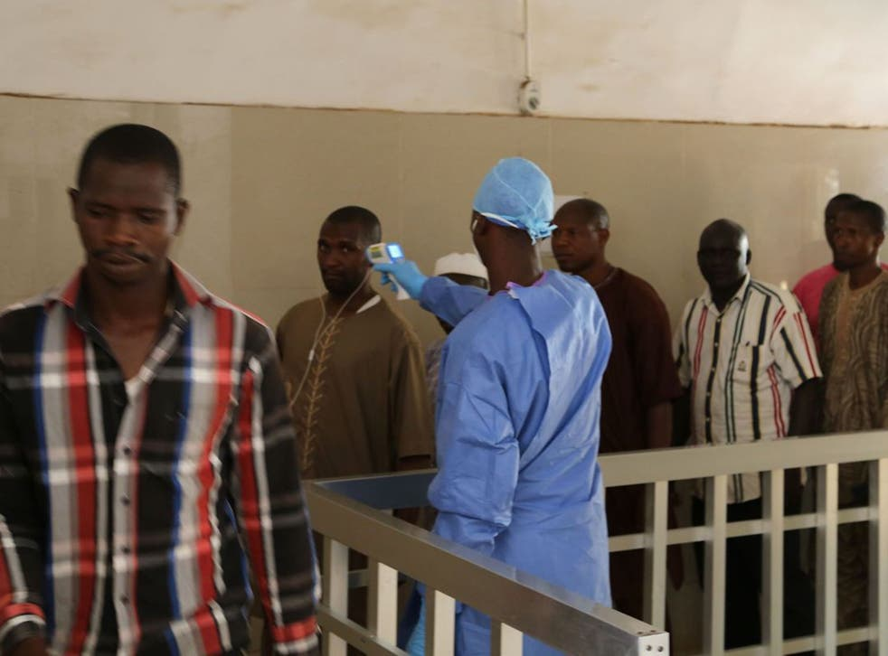 Health workers testing to see if people have Ebola in Guinea