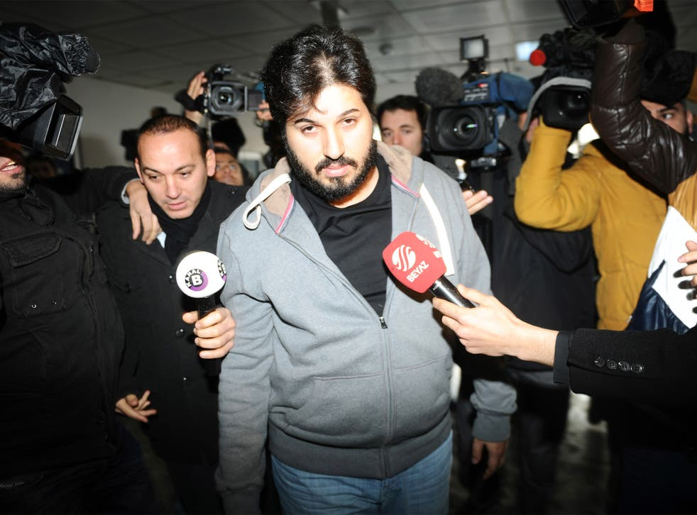 Reza Zarrab is surrounded by journalists at a police station in Istanbul in December 2013, in an inquiry that led to the resignation of three cabinet ministers