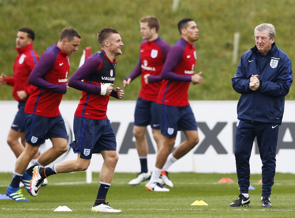 England manager Roy Hodgson watches Leicester striker Jamie Vardy during training at St George's Park