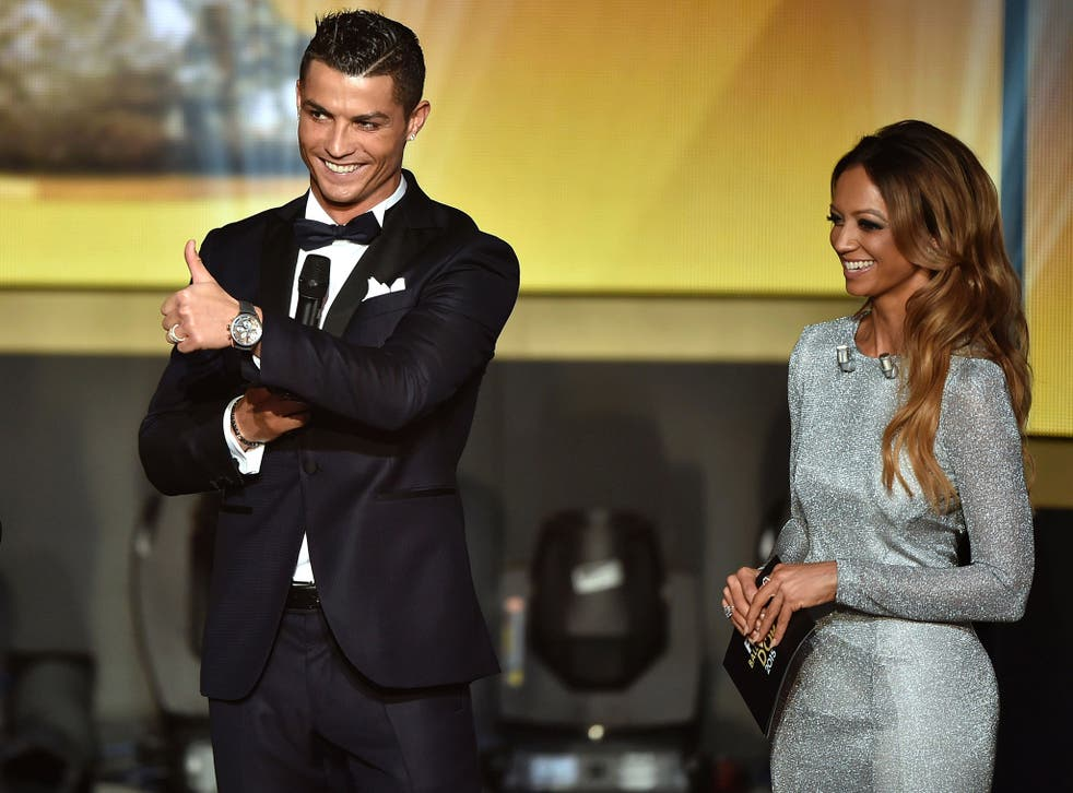Cristiano Ronaldo stands alongside Kate Abdo at the Fifa Ballon d'Or Gala