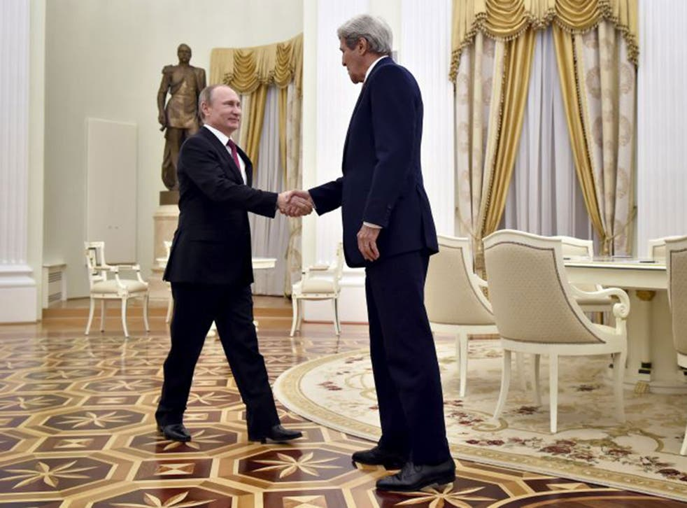 John Kerry shakes hands with Russian President Vladimir Putin during a meeting at the Kremlin in Moscow