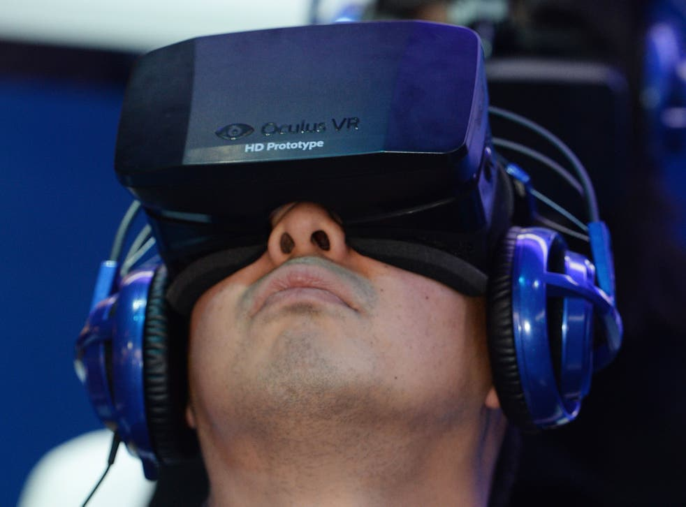 A man uses a prototype of the Rift at CES 2014