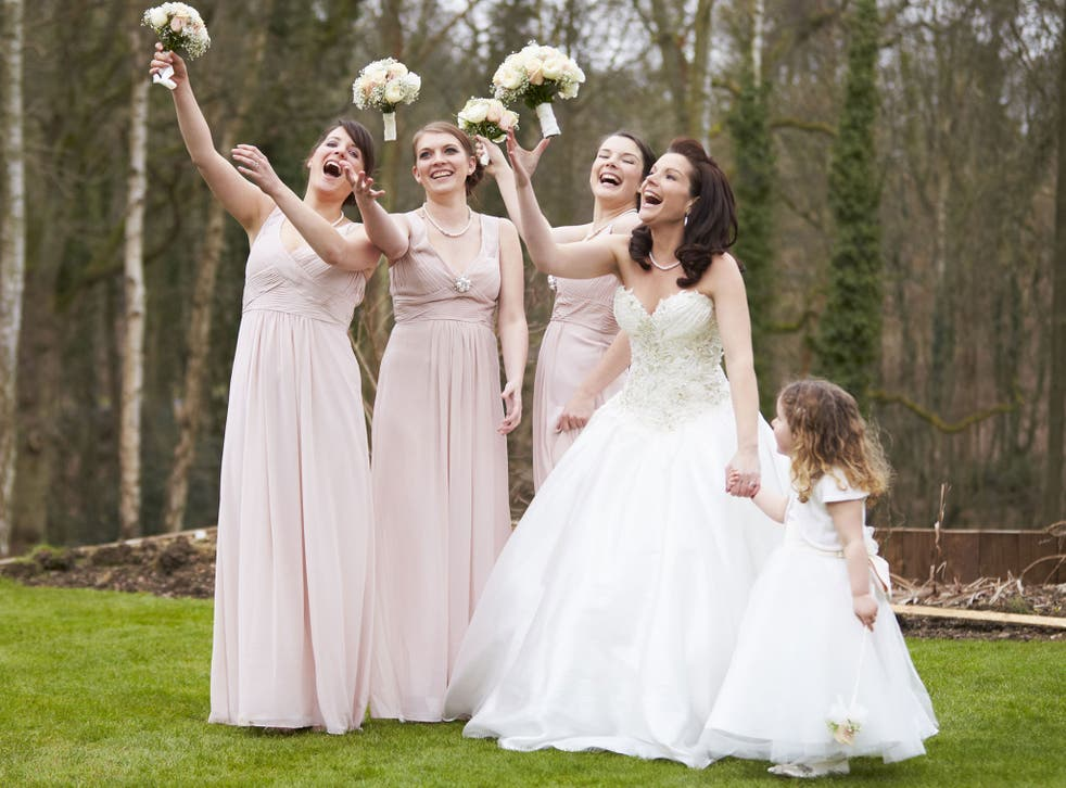 Bridesmaids traditionally wear similar or identical dresses