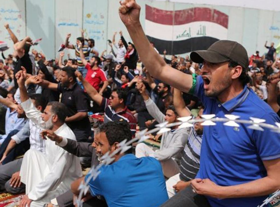 Protesters at one of the entrances to the Green Zone – a fortified area in the centre of Baghdad used by the government – after Friday prayers yesterday