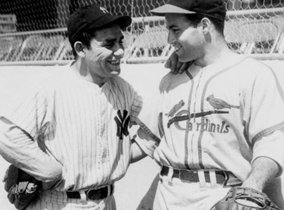 Yogi Berra (left) chats with Joe Garagiola at Yankee Stadium in 1947