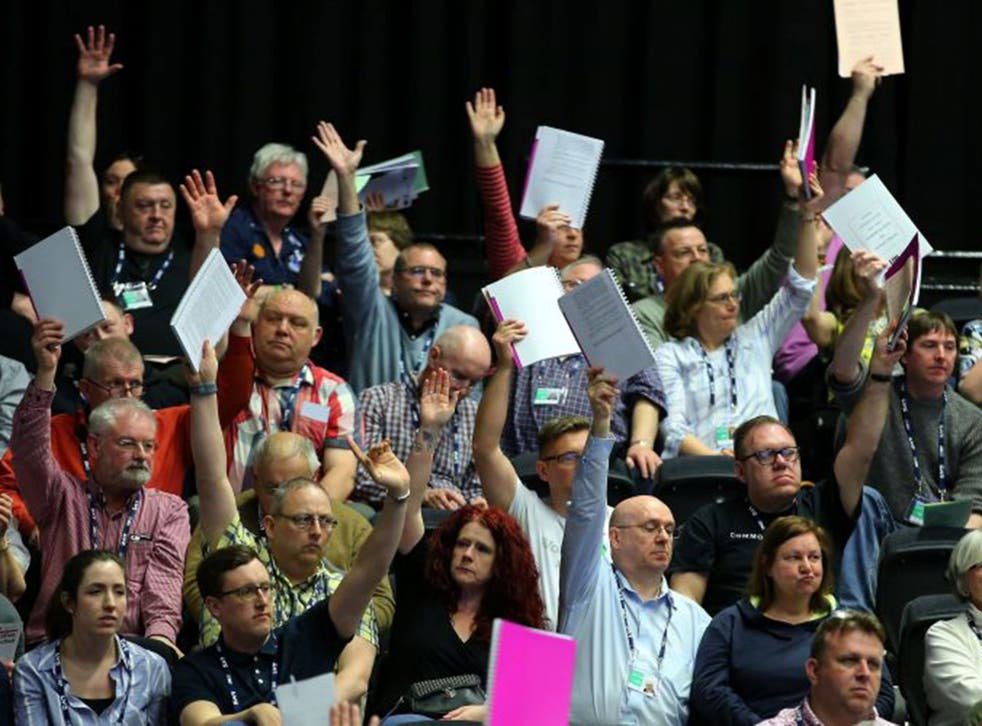 Delegates vote on a motion during the National Union of Teachers conference at the Brighton Centre