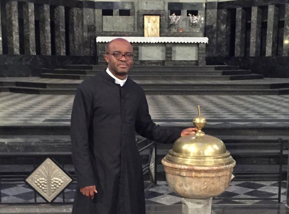 Father Aurelian Saneko preparing for an Easter service
