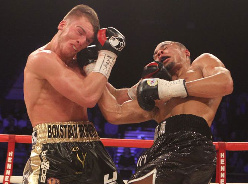 Nick Blackwell, left, and Chris Eubank Jnr exchange blows during their brutal title fight on Saturday night