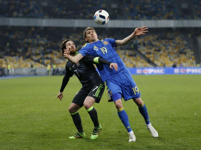 Wales midfielder Joe Allen battles for possession with the Ukraine's Denis Garmash during the friendly defeat for Chris Coleman's side