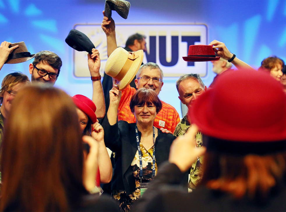General Secretary Christine Blower is joined on stage by delegates at the end of the conference in Brighton