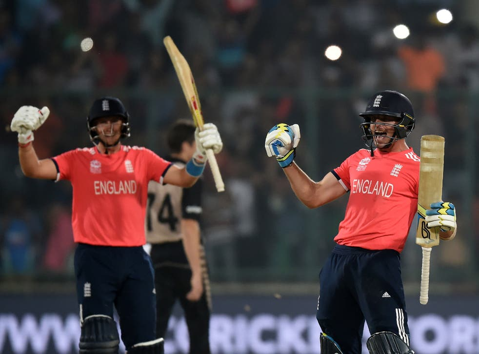 Joe Root (left) and Jos Buttler celebrate England's victory over New Zealand