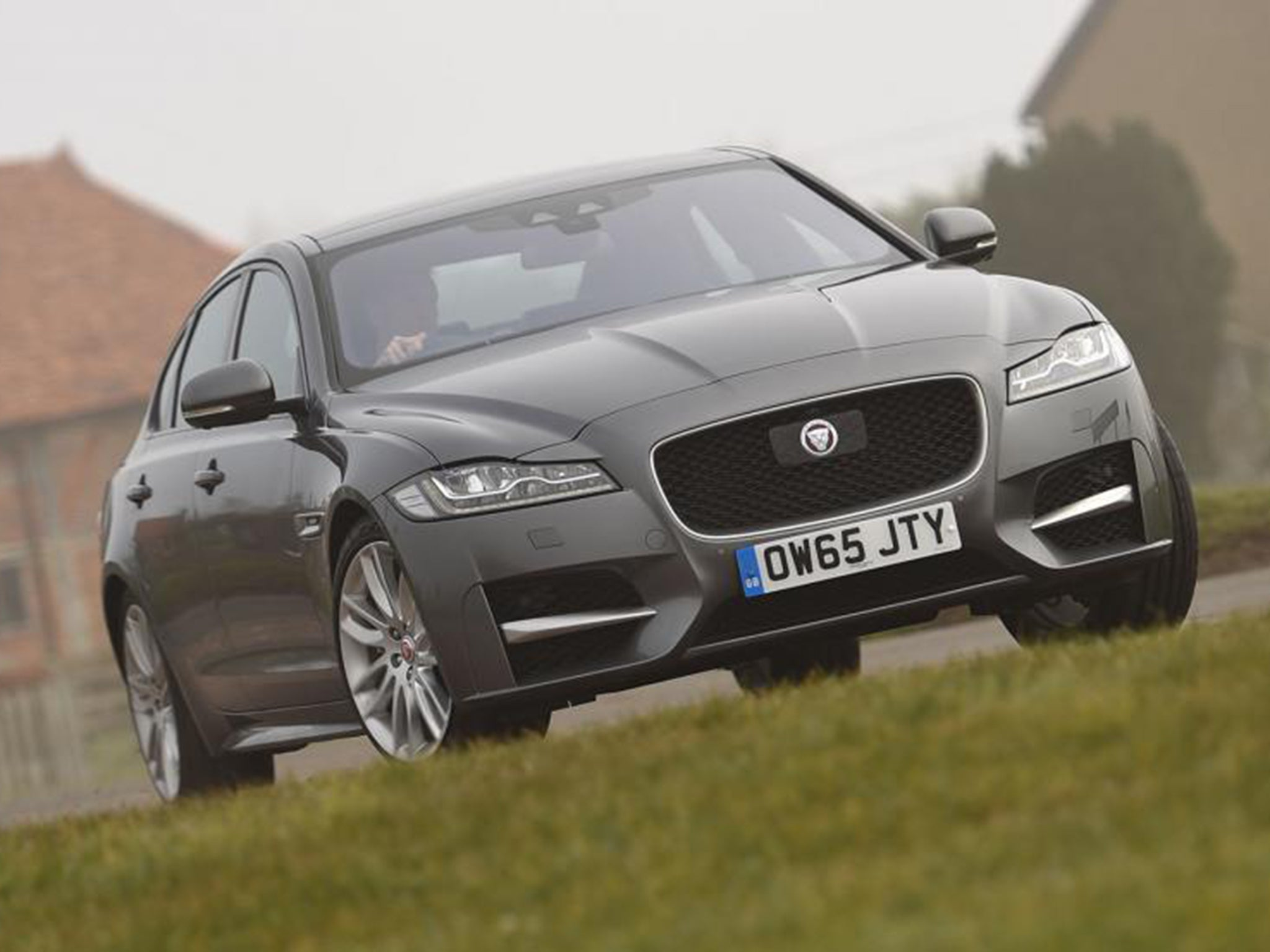 Jaguar xf 2 0d 180 awd r sport car review four wheel drive makes this a car for all roads and weathers the independent