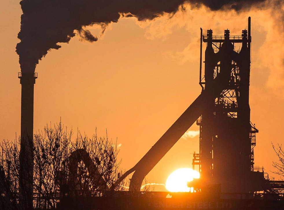 The sun rises above Tata Steel's Scunthorpe Plant in north east England