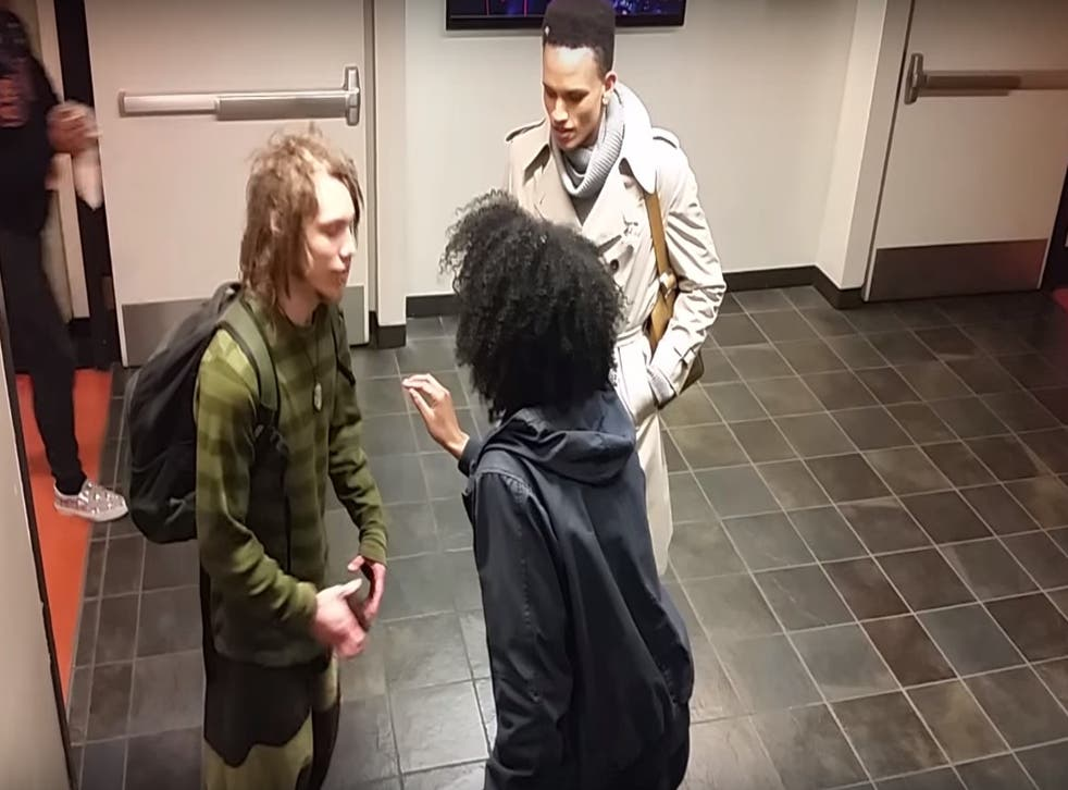 Goldstein, pictured left, is prevented from walking away from the row in the video