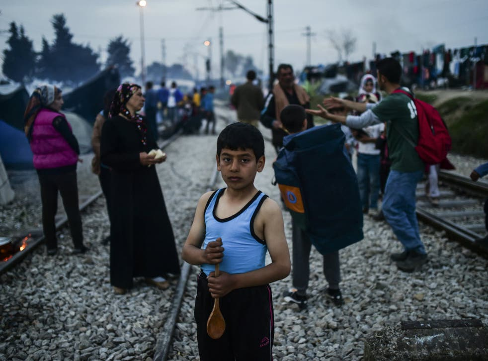 Refugees arriving in the Greek village of Idomeni