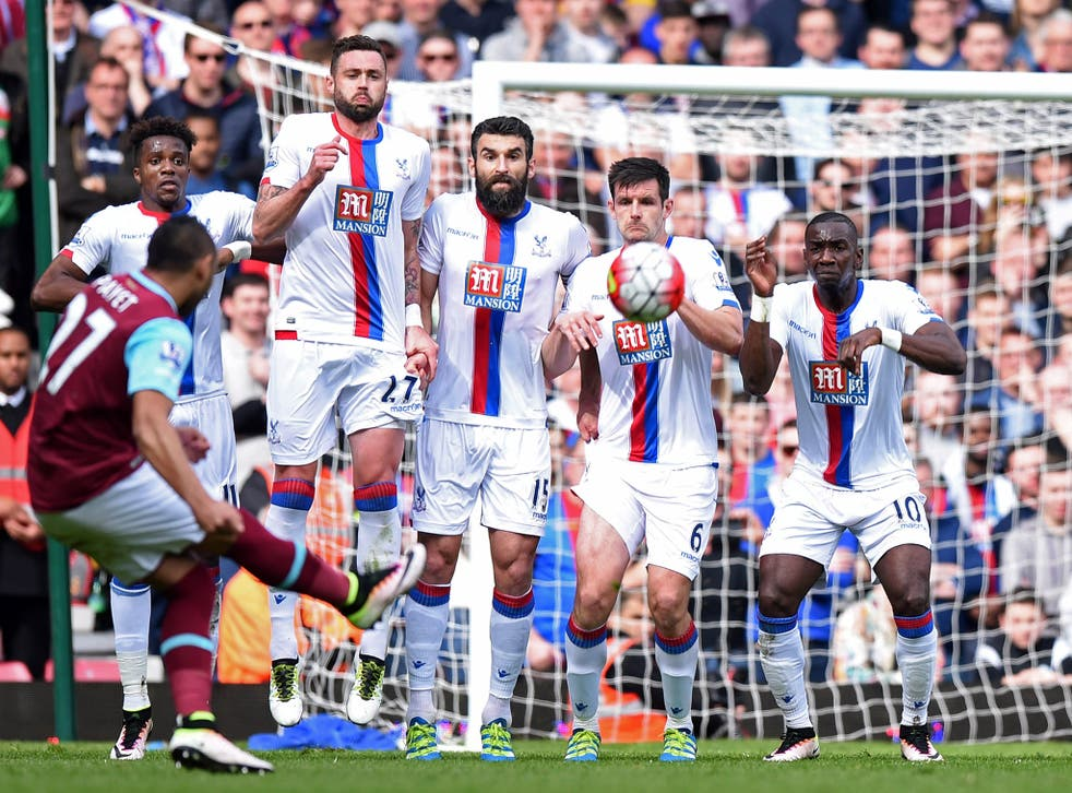 Dimitri Payet curls in a free-kick against Crystal Palace