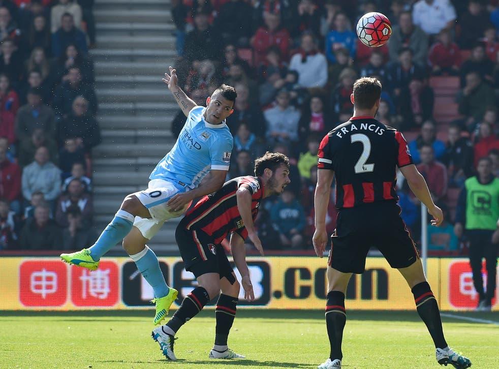 Sergio Aguero heads in Manchester City's third