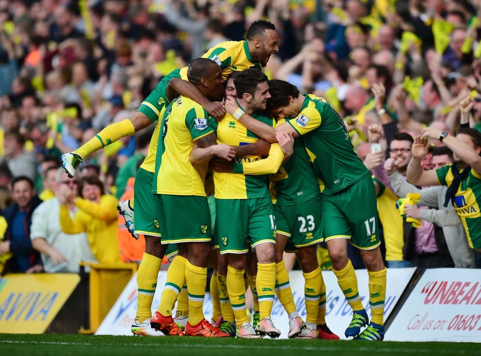 Martin Olsson is mobbed by his team-mates after his goal