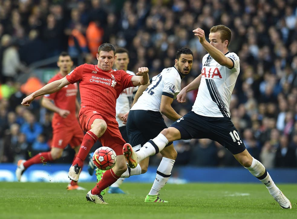 James Milner competes with Harry Kane for the ball