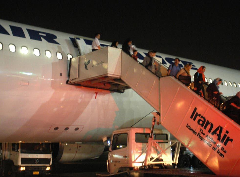 Passengers of Paris-Tehran flight of Air France take the stairs down to Tehran's Mehrabad airport in June 2004