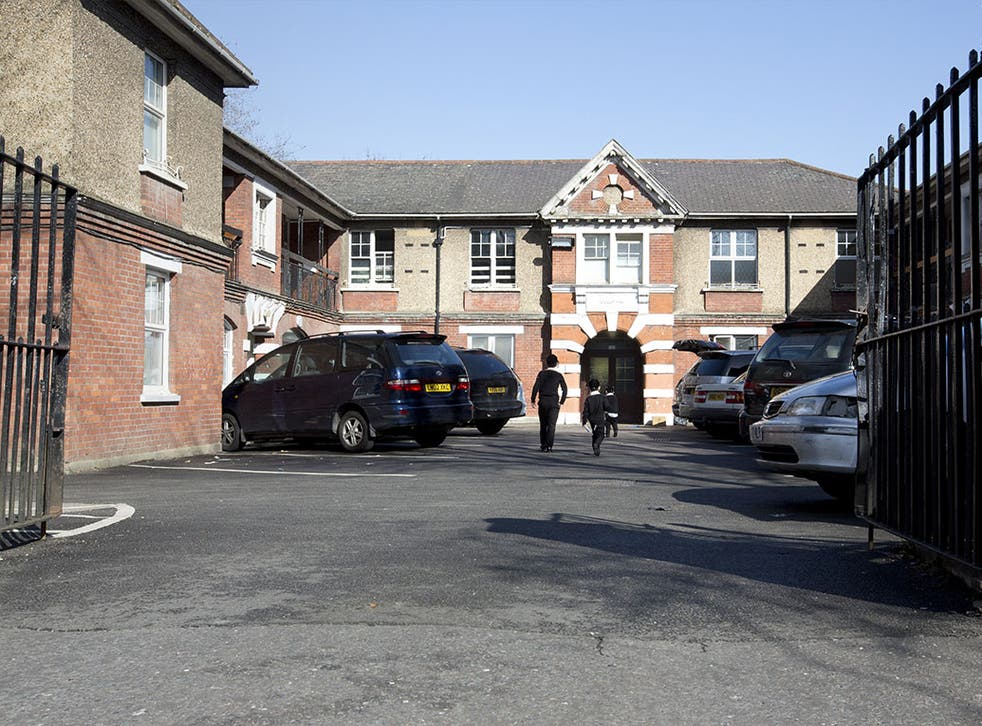 Ultra-Orthodox Jewish children seen arriving at a building in Stamford Hill