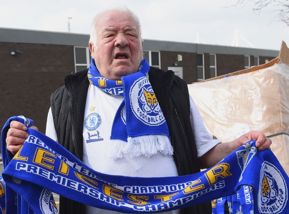 Scarves reading 'Leicester City Premiership Champions' being sold