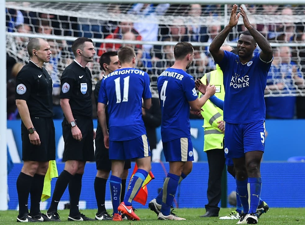 Wes Morgan (far right) applauds the home fans after the final whistle