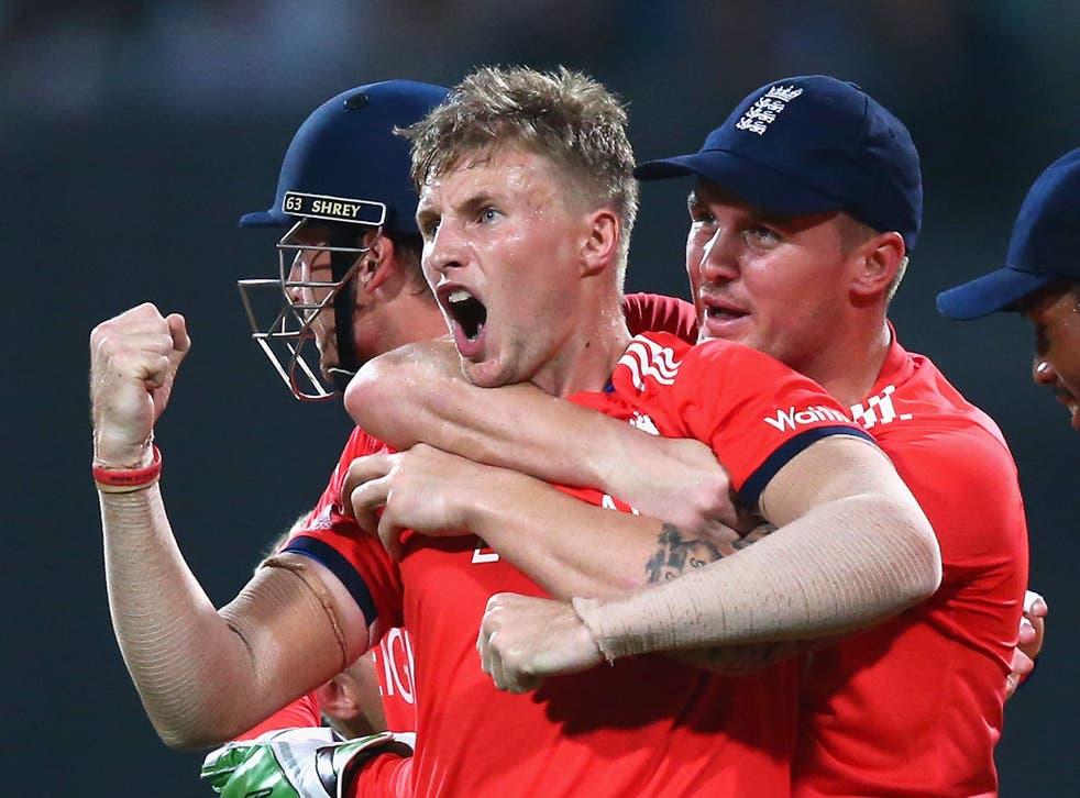 Joe Root celebrates taking the wicket of Chris Gayle