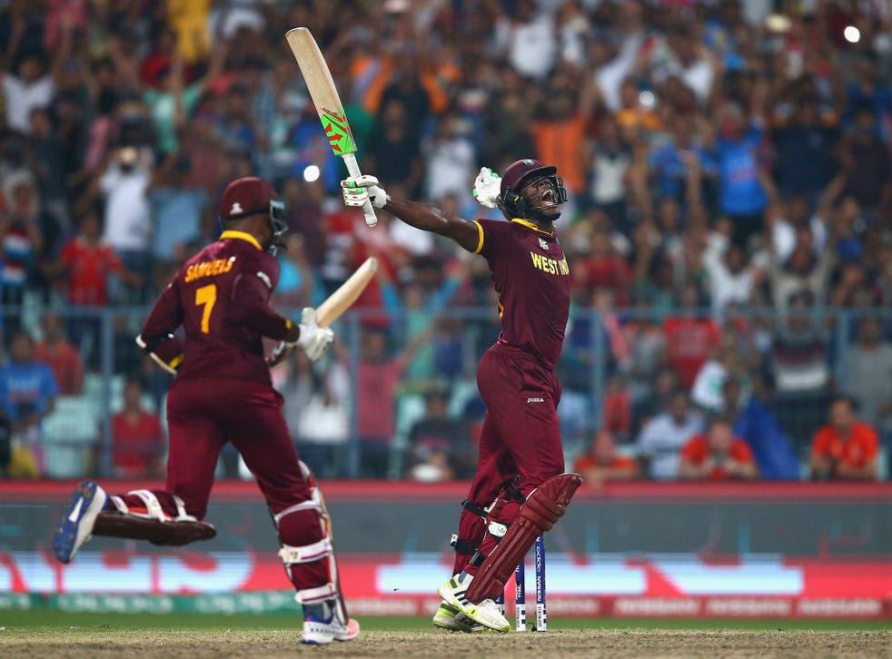 Carlos Brathwaite of the West Indies celebrates hitting the winning runs
