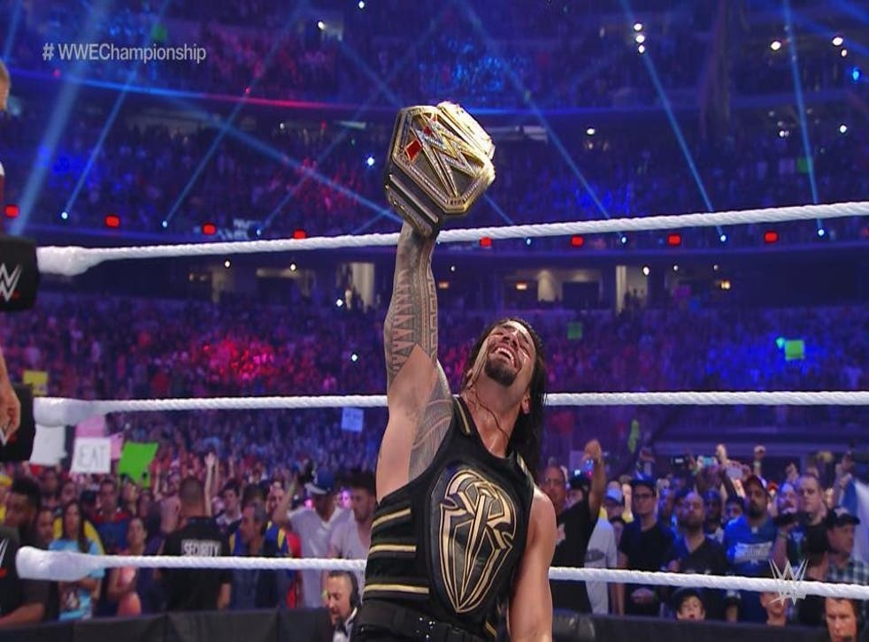 Roman Reigns celebrates his victory at WrestleMania over Triple H