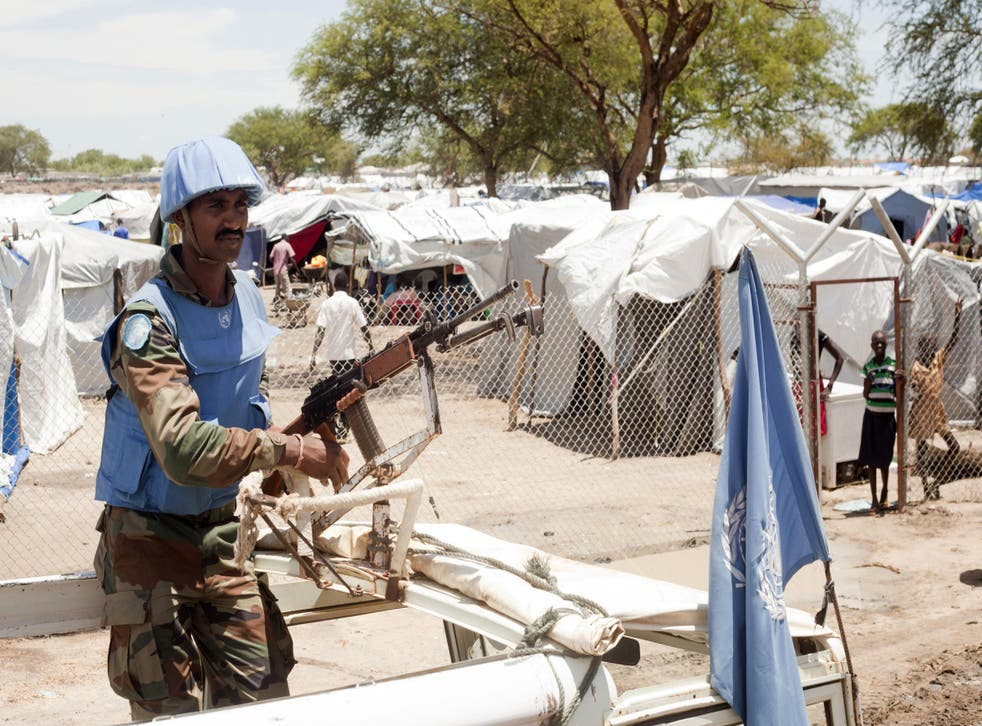 A United Nations peacekeeper keeps guard outside the Bor camp for the internally displaced in Bor town Jonglei state, South Sudan